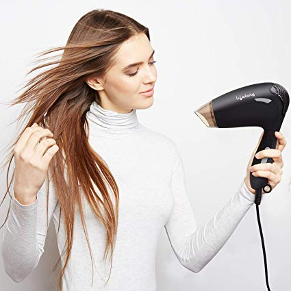 LIfestyle image of a woman using a hair dryer