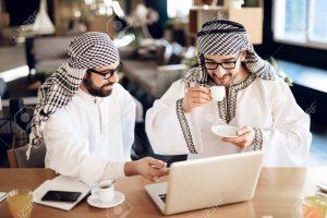 Two Arab businessmen enjoying coffee
