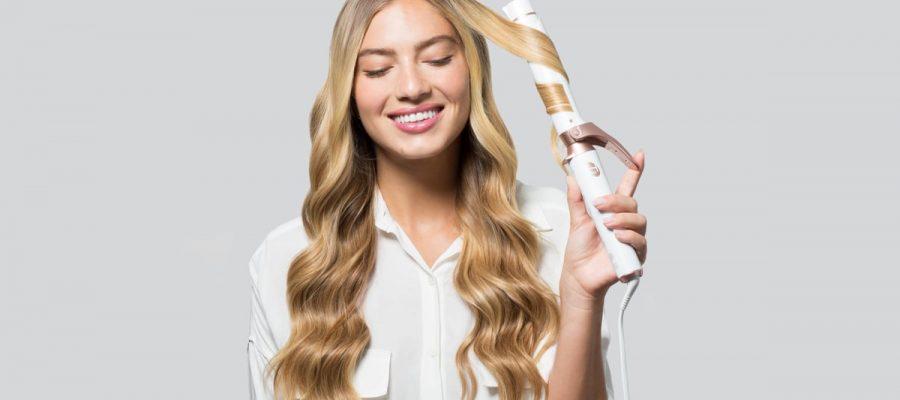 A woman using a hair curler